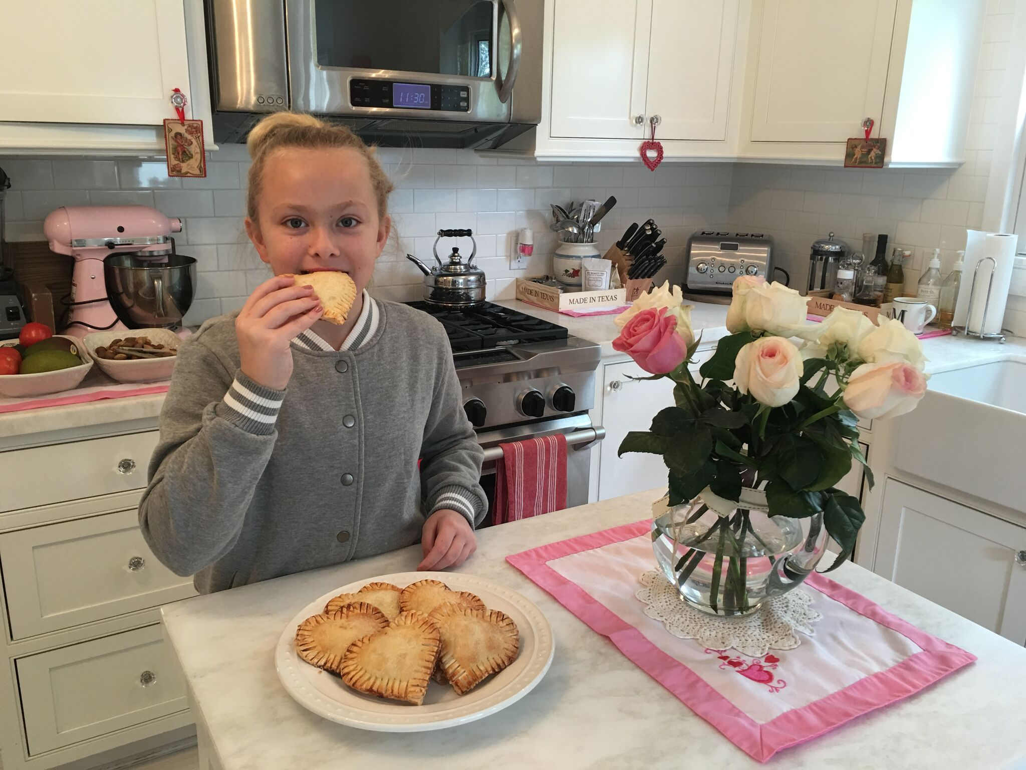 Molly Eating Heart-Shaped Pastries